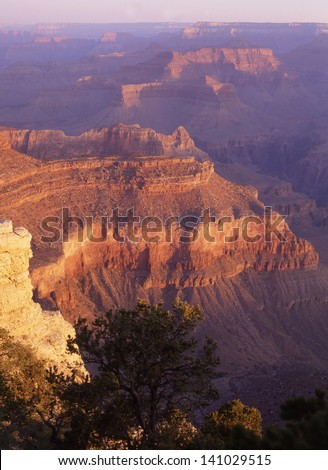 Grand Canyon National Park, Arizona/Grand Canyon/On a clear blue sky day, the best time to take pictures of the Grand Canyon is sunrise or sunset.  A stormy sky is also a great opportunity. - stock photo