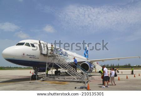 GRAND CAYMAN, CAYMAN ISLANDS - June 13  JetBlue Airbus A320 at Owen Roberts International Airport at Grand Cayman on June 13, 2014 - stock photo