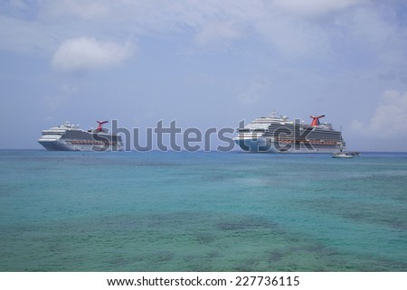 GRAND CAYMAN - JUNE 12: Carnival Dream  and Carnival Glory Cruise Ships anchor at the Port of George Town, Grand Cayman on June 12, 2014.  - stock photo