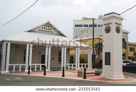 GRAND CAYMAN - JUNE 12: 1919 Peace Memorial Building and clock tower commemorating the Reign of King George V at George Town on June 12, 2014 - stock photo