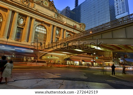 Grand Central Terminal, Manhattan, New York showing fast paced motion concept with blurred traffic and pedestrians - stock photo