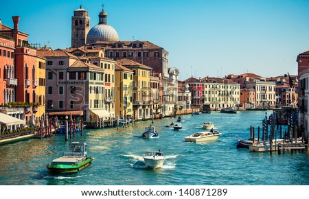 grand channel with boats and color architecture in Venice, Italy - stock photo