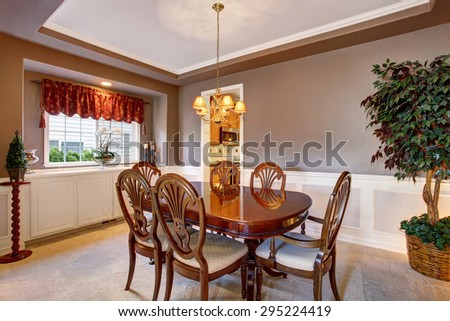 Grand dinning room with perfect table set, and decor. - stock photo