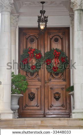Grand Doors with Christmas Wreaths - stock photo