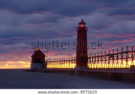 Grand Haven, Michigan Lighthouse at sunset, Lake Michigan, USA - stock photo