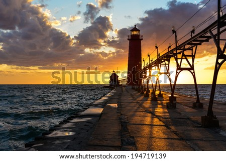 grand haven pier lighthouse - stock photo
