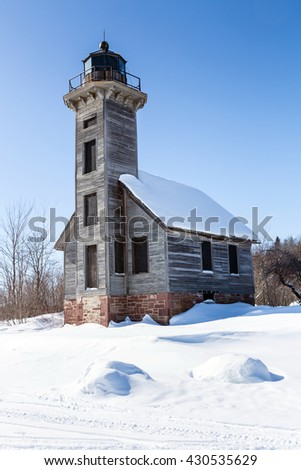 Grand Island East Channel Light surrounded by harsh winter conditions on Lake Superior. Located offshore from Munising Michigan. - stock photo