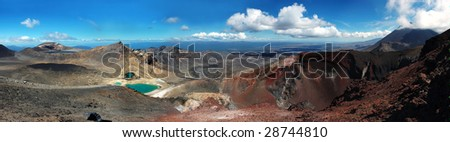 Grand panorama of Tongariro Crossing, New Zealand. Vulcano Ngauruhoe, Red Crater, Emerald Lakes and Blue Lake. - stock photo