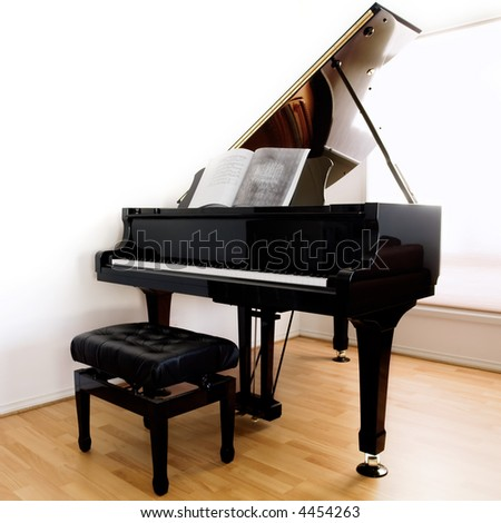 Grand Piano and stool on modern floorboards - stock photo