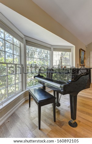 Grand Piano in a living room of a luxury house. - stock photo