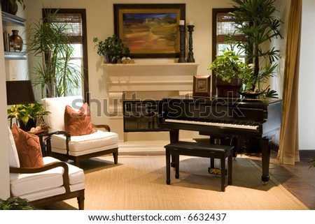 Grand piano in a residential music lounge. - stock photo