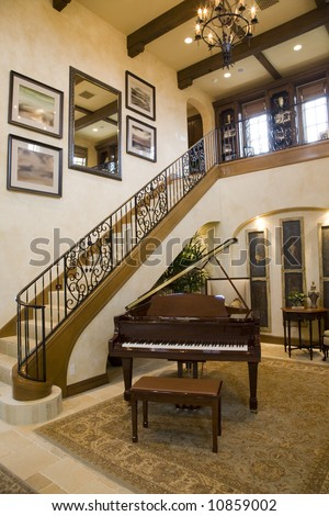 Grand piano in a spacious luxury home. - stock photo