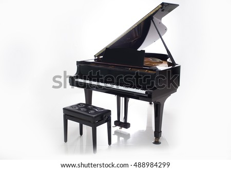 Grand piano on a white background.
