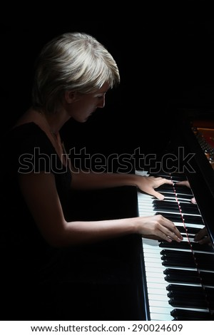 Grand Piano pianist concert playing Piano Player classical musician - stock photo
