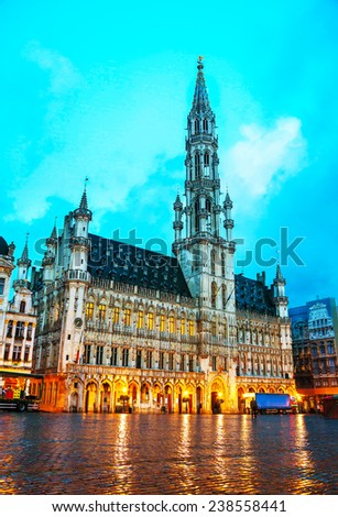 Grand Place with City Hall in Brussels at sunrise - stock photo