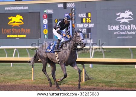GRAND PRAIRIE,TX - JULY 4th: Jockey riding his horse at Lone Star Park Horse Race July 4th, 2009 in Grand Prairie, Texas. - stock photo