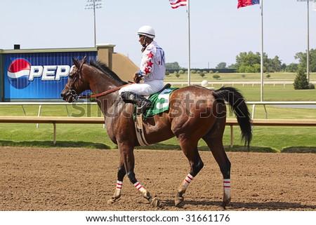 GRAND PRAIRIE,TX - JUNE 6th: Jockey riding his horse after race  at Lone Star Park Horse Race June 6th, 2009 in Grand Prairie, Texas. - stock photo