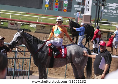 GRAND PRAIRIE,TX - JUNE 6th: The winner of the 8th Race, Kelsi Purcell and horse Sushi Joe at Lone Star Park Horse Race June 6th, 2009 in Grand Prairie, Texas. - stock photo
