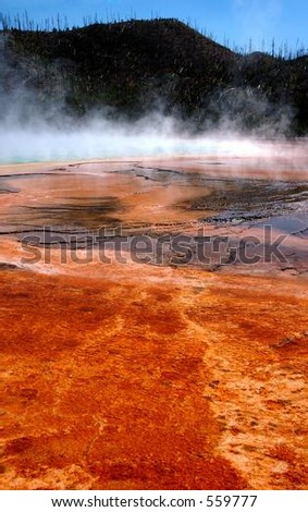 Grand Prismatic Hot Springs mud flats in Yellowstone National Park, Wyoming - stock photo