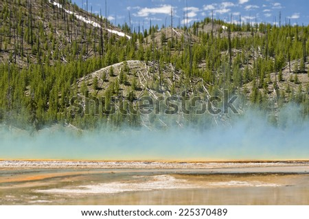 Grand Prismatic Spring as they  walking along path in Midway Geyser Basin, Yellowstone National Park, Wyoming - stock photo