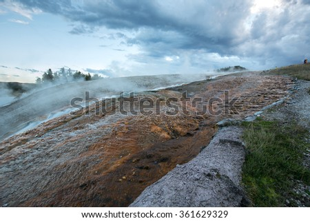 Grand Prismatic Spring in Yellowstone National Park (sunset hours). - stock photo