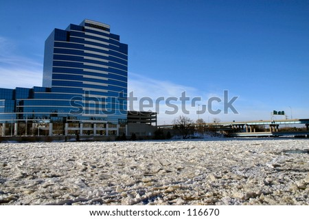 Grand River in downtown Grand Rapids, Michigan on a very cold Winter day. - stock photo