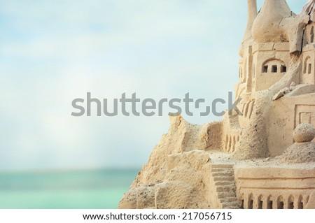 Grand sandcastle on the beach  - stock photo