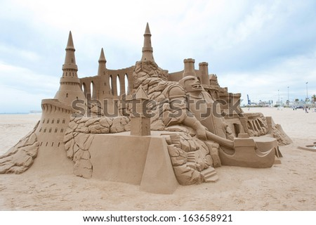 Grand sandcastle on the beach during a summer day. - stock photo