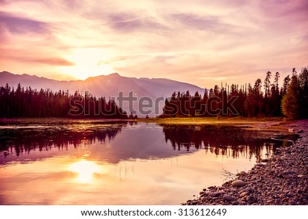 Grand Teton mountain range at sunset, Jackson Lake, Grand Teton National Park, wyoming, USA - stock photo