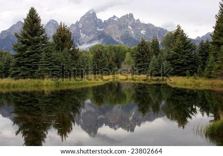 Grand Teton mountains reflected in Snake River, Wyoming - stock photo