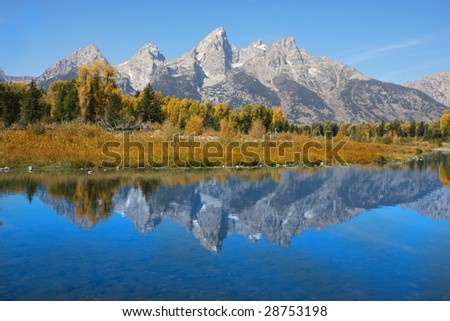Grand Teton National Park in the fall showing reflections - stock photo