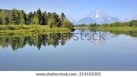 Grand Teton National Park - Reflection of the Grand Teton Mountains in the Snake River at Oxbow Bend - stock photo