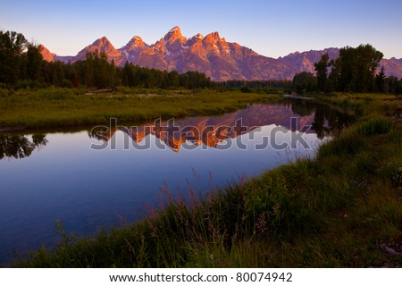 Grand Teton sunrise reflecting in beaver pond at Schwabacher Landing - stock photo