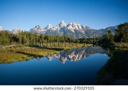 Grand Tetons peaks and their reflections in Wyoming, US - stock photo