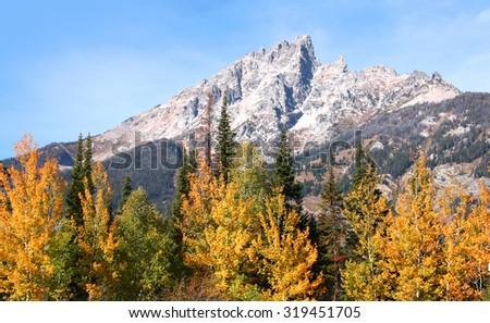 Grand Tetons peaks in autumn time - stock photo