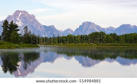 Grand Tetons Reflections in River -  Yellowstone National Park, United States.