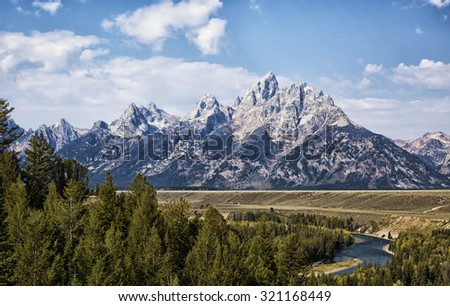 Grand Tetons, with the Snake River in the foreground.  - stock photo
