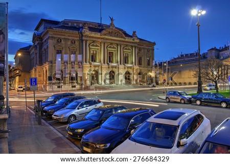 Grand Theatre de Geneve in Geneva, Switzerland at twilight, towering over Place Neuve. - stock photo