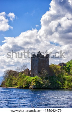 Grand Tower of the Urquhart Castle in Loch Ness in Scotland. Loch Ness is a city in the Highlands in Scotland in the United Kingdom. - stock photo