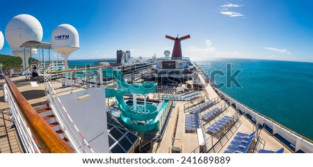 GRAND TURK - NOVEMBER 20 : Panorama shot of open sky deck of Carnival Liberty on November 20, 2014 in Grand Turk. - stock photo