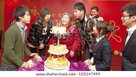 Grandchildren to congratulate grandmother a happy birthday on grandmother's 90 years birthday party