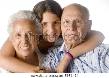 granddaughter embracing her grandparents - stock photo