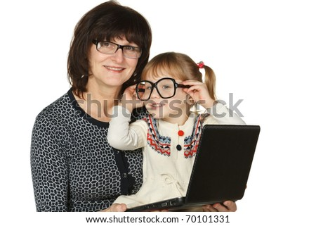 Granddaughter fooling with grandmother's glasses isolated on white - stock photo