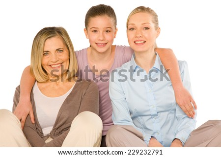 granddaughter grandmother young mother sat on white background - stock photo