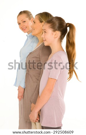 granddaughter grandmother young mother standing on white background - stock photo