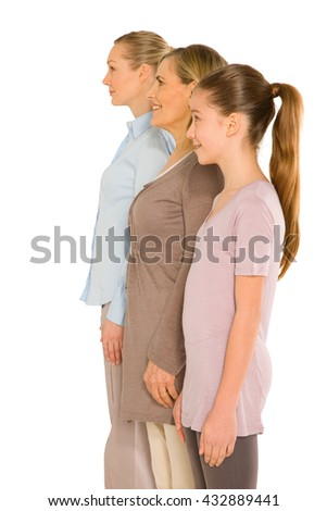 granddaughter grandmother young mother standing on white background, three generation - stock photo