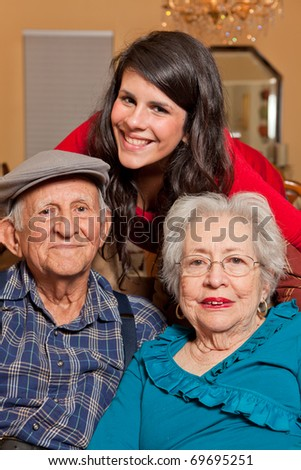 Granddaughter with Grandparents lifestyle in a home setting. - stock photo