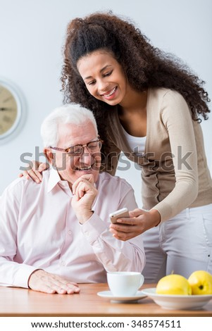 Grandfather and adult granddaughter spending time together - stock photo