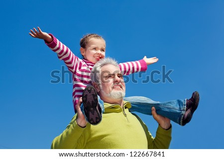 Grandfather and grandchild happy together - stock photo