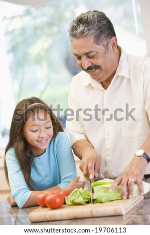 Grandfather And Granddaughter Preparing meal,mealtime Together - stock photo
